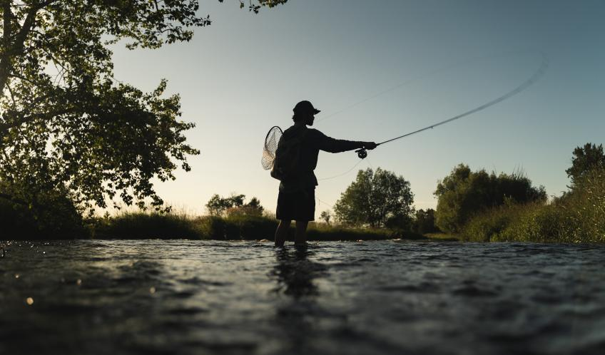 A picture of Theodore Benjovsky fishing on the Wallowa river.