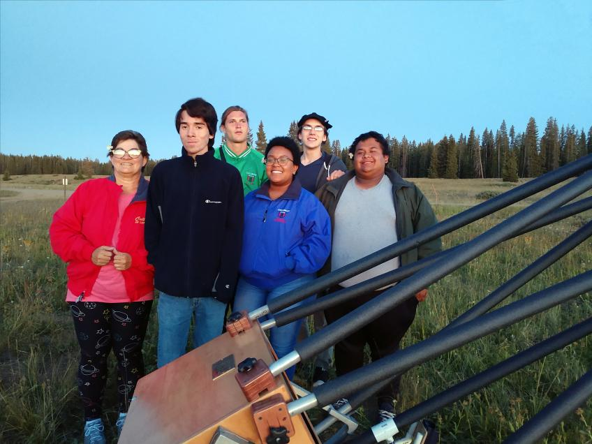 Gruop photo in front of telescope