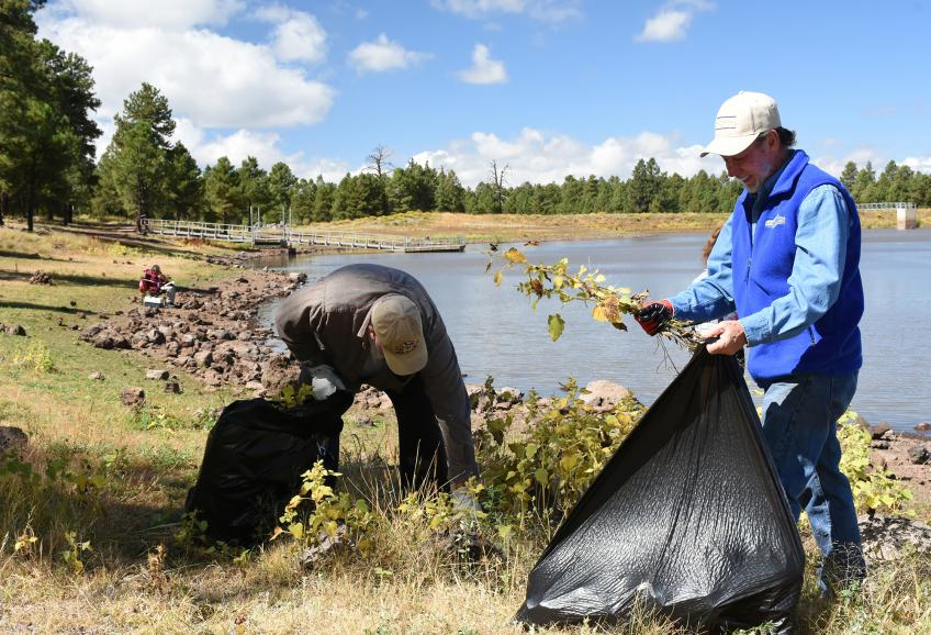 Volunteers clean up the edges of Kaibab Lake.
