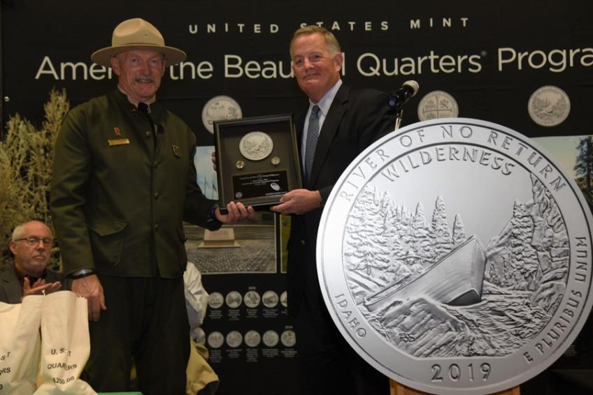 A picture of Salmon-Challis National Forest Supervisor Chuck Mark and U.S. Mint Director David J. Ryder at the ceremony celebrating the new quarter.