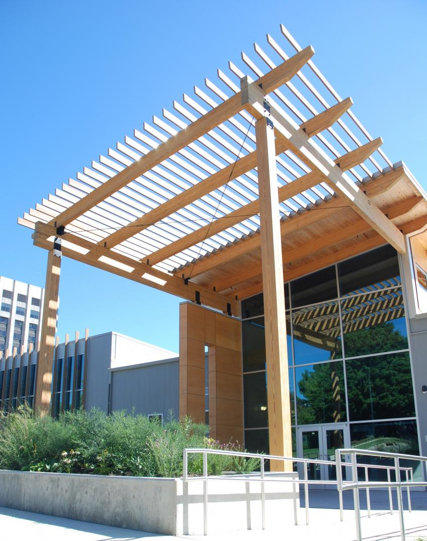A picture showing structurally engineered glulam timbers at the Forest Products Lab Centennial Research Facility.