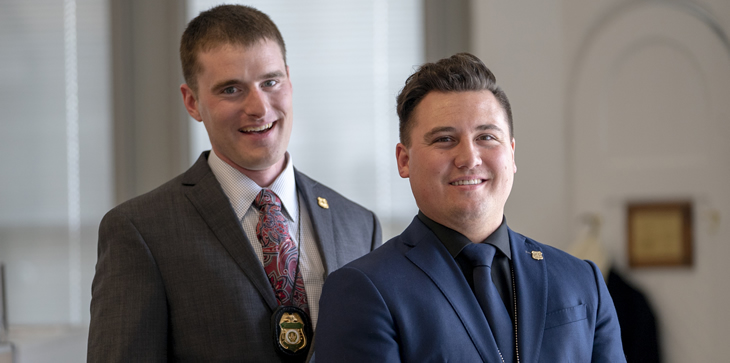 Nichols Scholz and Patrick Legg, Forest Service Law Enforcement officers, pose for a portrait after receiving the USDA Unsung Hero Award, Washington D.C.